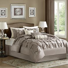 This beautifully tufted bed is from the Laurel bedding collection. Its neutral taupe coloring makes this set easy to accessorize in your bedroom.