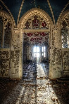 Arched portal, Sunlight amid ruins at the Chateau de Noisy in Belgium.