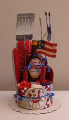 Red, White & Blue BBQ Kitchen Towel Cake with BBQ Tools & Sauce - The Flourless Bakery        FOR JOHN'S GROOM SHOWER