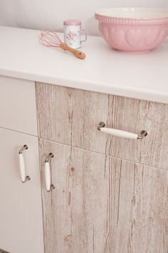 Kitchen cupboards can be transformed in an instant with d-c-fix® sticky back plastic. Here the plain white doors have been given a distressed wood look with Pino Aurelio woodgrain design