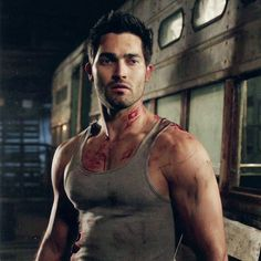 Tyler Hoechlin as Derek Hale with blood stains.