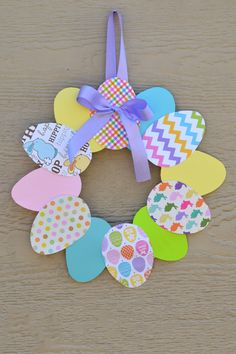 Easy Paper Easter Wreath:  Supplies for this wreath will cost you less than $5, and you'll love how the spring colors brighten your home.