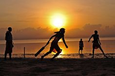 March 6, 2012. Players in the Maasai Warriors cricket team play cricket on the beach in Mombasa, South East Kenya. The team is made up of Maasai warriors from the Laikipia region of Kenya who are aiming to be role models in their communities, where they are trying to promote healthier lifestyles by spreading awareness about HIV/AIDS, and fighting for the rights of women by actively campaigning against Female Genital Mutilation and early childhood marriages.