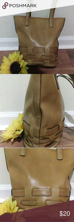 Nine West bucket bag Beautiful tan leather Nine West bucket bag. dark brown piping around the bottom and the basket weave pattern. two straps pen holders inside lots of compartments has stains on the inside will clean up nicely .EUC 30-inch drop 12 inches across Nine West Bags