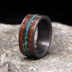Titanium Wedding Rings Meteorite Shavings Cocobolo Band and Blue-Green by HolzRingShop - 10 mm wide comfort fit carbon fiber band, with a 6 mm meteorite shavings inlay, mm cocobolo rosewood inlaid bands and a 1 mm blue green Baguette Diamond Rings, Diamond Cluster Ring, Diamond Earrings, Engagement Ring Settings, Diamond Engagement Rings, Solitaire Engagement, Wedding Men, Wedding Bands, Rustic Wedding