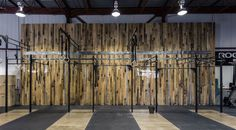 What's the best use for an old garage in an up and coming neighbourhood? That's a no-brainer. A Crossfit gym is the ideal tenant for such a space. Wood accent walls provide an organic feel to the industrial structure. Designed in house, the space is maximized and purpose built without sacrificing style.