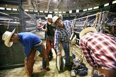 Newt Mattson, left, of Okeechopee, and Clay McIntyre, center, of Wachula, both professional bull riders, prepare for the PBR bull riding event at Germain Arena in Estero on Friday, June 18, 2010. Photo by Tristan Spinski