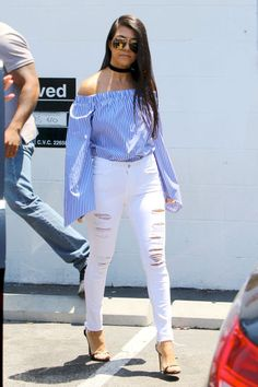10 ways to style white denim this summer: Kourtney Kardashian wears a blue striped off-the-shoulder top, black choker and heels with her white ripped skinny jeans