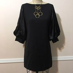 Bebe Brand New LTE Wool/Satin Black Dress w. NL New Bebe light weight wool with satin puff sleeves black dress. Never worn. Accessorized with Marciano gold mix circle NL. FREE with the dress! ❤️❤️❤️ bebe Dresses