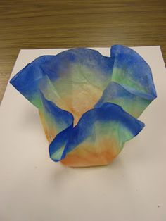 Coffee filter, use watercolor to paint, spray with spray starch, put over a bottle to dry...