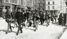 May 1916, A party of Sinn Feiners, including a bearded old man, marched away under escort, The Irish rebellion began on Easter Monday 24th April 1916 when the Irish rebels attempted to gain control of public buildings in Dublin, but they were doomed to failure
