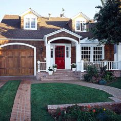 Love these garage doors and love the red door too!  Also, notice the LACK of a concrete driveway... in love with this whole look.