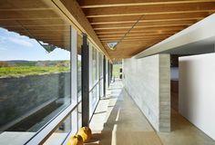 Glulam beams, poured concrete wall for interior walls