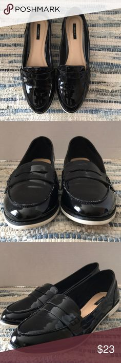 FOREVER 21 Black Penny Loafers Sz 9 Very fancy and stylish faux patent leather penny loafers by Forever 21  Tag Size: 9(EU 39) Color: Black w/ white sole Material: Corte and Polyurethane  Condition: Very good pre owned condition. Only real noticeable wear is the discoloration of sole from normal use. Very little creasing and no scratches found. Inside is clean! Forever 21 Shoes Flats & Loafers