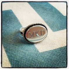 The perfect monogram ring, this sterling silver ring will feature your monogram engraved into a silver setting with gorgeous oxidized rope detailing around the edge. This ring is made to order so please enter the initials or name to be engraved below. Monogram rings are one of our most popular pieces and make for a lovely treat for yourself or others {yes, they make for a stunning bridesmaid gift!}. Engraved locally here in Atlanta, we offer quick turnaround. Traditional monograms appea...