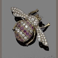 A ruby and diamond bee brooch,