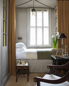 Jack's room, grey and olive green with striped walls and canvas curtain.