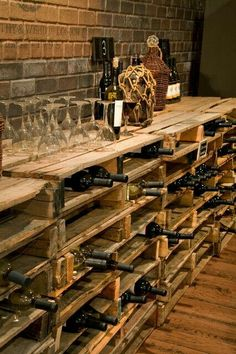 A great use for old palates, wine storage and side table all in one!