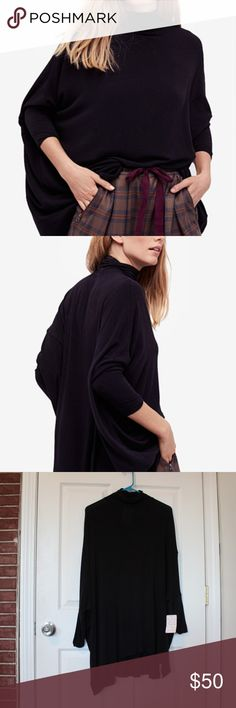 "FREE PEOPLE Oversized Turtleneck Top NWT New with tags! Black Free People turtleneck top. This top is gorgeous and effortless. It is a light knit top with a turtleneck and dolman sleeves. Women's size small. 81% Rayon, 14% Wool, 5% Spandex. 32""long. Free People Tops Blouses"