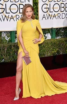 In canary Giambattista Valli Haute Couture dress at the 73rd Annual Golden Globe Awards in Beverly Hills, California.