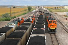 https://flic.kr/p/HhoZxx   Busy times at East Alliance   As an empty BNSF coal train passes through East Alliance, three coal loads wait their turn to head east. Off in the distance, the headlights of another westbound are right behind, passing the DPU of another coal load. A busy afternoon on the Sand Hills Subdivision in Nebraska… pity the guys trying to get track-and-time to work on one of the switches in the crossover! This was on September 15, 2013—I wonder what it is like now…