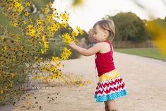 Toddler portrait, flowers and boots. Raleigh lifestyle child photographer » Kim OBrien Photography