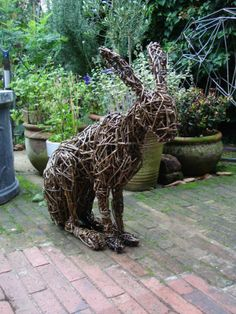 Sculpture: 'Willow HARE. (Woven Outdoor Wild Life Animal statues)' by sculptor Emma Walker in Wild Animals and Wild Life Sculptures - ArtPar...
