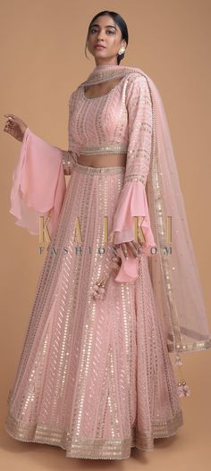 Peach Pink Lehenga Upon order confirmation, we will send you a measurement chart which you will need to fill in inches. It can be customised in any color of your choice. Indian Gowns, Indian Attire, Indian Outfits, Indian Designer Outfits, Designer Dresses, Lehenga Designs, Kurta Designs, Dress Designs, Blouse Designs