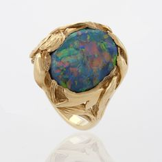 Van Cleef & Arpels Black Opal and 18 karat Gold Art Nouveau Style Ring.  Available exclusively at Macklowe Gallery.