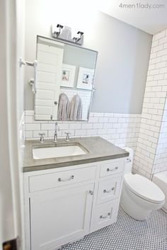 I love the concrete counters, the penny tile floor, subway tile with the dark grout, and the tilt mirror.  Basically the exact bathroom I want for the kids but a bit brighter.