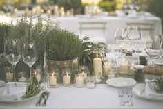 Today, our resident real bride Claire is talking all about her and Marko's wedding decor with fun signage, herb pot centrepieces, and string lights outside.