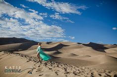Oh wow so pretty pregnancy photos in beautiful maternity gown at Sand Dunes Maternity Photography by Katie Corinne Photography Baby Bump, expecting mommy photos, pregnancy portraits, Maternity photographer.  An EPIC Sand Dunes maternity session with my friend! Isn't she stunning?  #maternityphotos #coloradomaternityphotographer #coloradospringsmaternityphotographer #babybump #sanddunes #pregnancyphotos