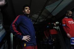 Lionel Messi of FC Barcelona looks out from the players tunnel prior to the start the La Liga match between Sporting Gijon and FC Barcelona at Estadio El Molinon on February 17, 2016 in Gijon