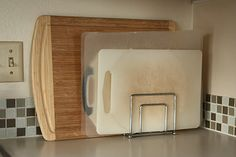 napkin holder to organize cutting boards.. although i wouldnt keep on countertop..