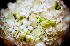 the little pearl details in the small white flowers is such a delicate touch