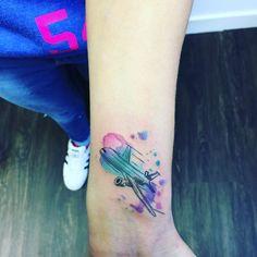 Watercolor passenger plane tattoo via Niamh