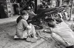 Learning the trade.  #mechanic #garage #workshop #motorcycle #motorbikes #saigon #hcmc #vietnam #ig_vietnam #wanderlust #streetphotography #streetleaks #streetlife #streetlife_award #wearethestreet #ourstreets #storyofthestreet #bnw_zone #bnw_kings #bnw_life_shots #bnw_of_our_world #bnw_one #bw #bwchallenge #bw_instantscatcher #blackandwhitephoto #blacknwhite_perfection #noir #noiretblancphotographie #monochrome