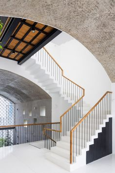 The floors of this house are connected by a large, white terrazzo staircase on the east edge, while the second-floor bedrooms are connected via a bridge that overhangs the first floor. Dezeen, Open Up, Vietnam, Living Spaces, Stairs, House, Terrazzo, Second Floor, Architecture