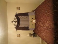 Just finished this! our homemade headboard, seriously guys, just hang drapes to match your bedding!! SO EASY!