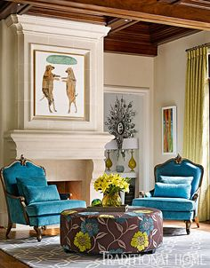 A pair of blue velvet bergères sit around an ottoman in a bold oversized floral with chartreuse and turquoise blooms on a brown background. - Photo: Emily Jenkins Followill / Design: Tish Mills