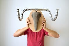 Antler trophies composed of used bicycle parts. Mounted on a wooden plate and able to carry heavy load.