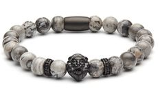 - Authentic grey jasper stones - High quality black matte rhodium plating - Zorrata logo back piece