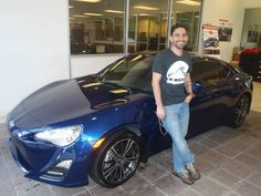 Ernest Morales with his beautiful blue 2013 Scion FRS! Welcome to the #DavidMaus #Toyota family! #WhateverItTakes