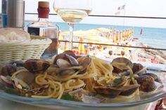 spaghetti alle vongole with a glass of wine taste much better on the seaside (Ligurian cost, Italy).