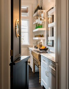 Amazing butlers pantry with Dutch door, porthole window, shiplap walls and white floating shelves | Palmetto Cabinet Studio