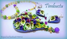 Extremely vibrant colours in a polymer clay neckpiece, strung with semi precious stones