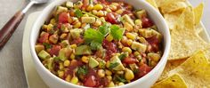 Part salsa, part guacamole, all delicious, this quick dip goes together fast with prepared salsa and canned corn blended with bell peppers.