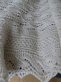In 2013, I fell in love with two baby blankets, both soft-draping, patterned and lacy. The first one was the Yarn Harlot's Baby Blanket completed in October 2013 and the second was the blanket Prince George had been swaddled in when he left the maternity hospital earlier that year. Sadly neither has an available pattern: the first was a special gift and SPMcP didn't publish her design so she could keep it unique, whilst the second was a mass-produced, manufactured blanket.