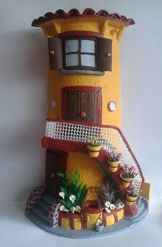Teja decorada con escaleras, pozo y plantas