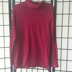 Mossimo worn once tissue t turtleneck This is a little darker than shown in photos. More like first photo.  Worn once. Light and soft. Tissue tee. 10 percent cotton . Smoke free home. Turtleneck top but not super tight. Like a deeper fuschia. Mossimo Supply Co Tops Tees - Long Sleeve